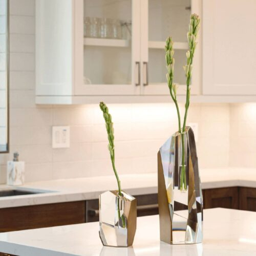 Two Crystal Brass Vases decorate a kitchen island