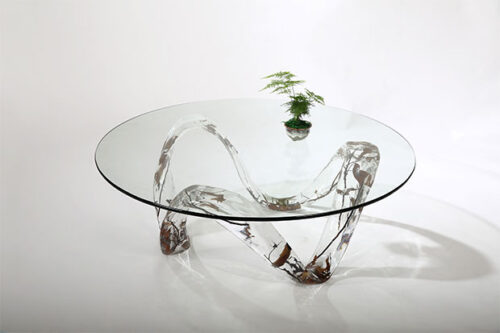 Round crystal and glass table with branches