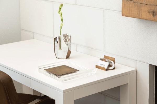 Modern decor: crystal and brass vase on desk