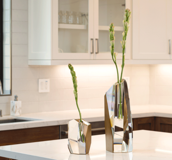 modern crystal and brass vases in kitchen